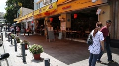 Restaurants on the main promenade in Stanley town in Hong Kong island Stock Footage