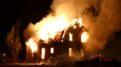 4K UHD - House completely involved in flames at night  Stock Footage