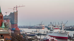 philharmonic building and harbor with container ships, evening timelapse - stock footage