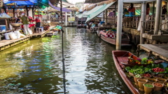 Bangkok floating market with cooking people on a boat timelapse Stock Footage