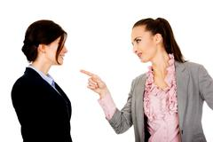 Stock Photo of Angry businesswoman accuses her partner.