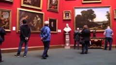 At the art gallery. Visitors  and  paintings . Stock Footage