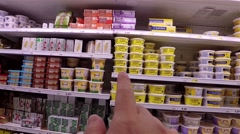 Hand pointing serial about picking Becel cream - stock footage