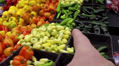 Hand pointing serial about picking orange pepper - stock footage