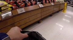 Man carrying basket to buy food inside superstore Stock Footage
