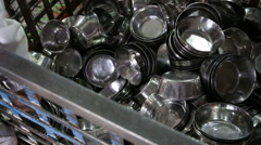 Pile of washed silver cups at public kitchen in Amritsar. Stock Footage