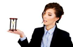Businesswoman holding hourglass. - stock photo
