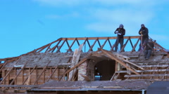 Crew removing the roof from an older home in preparation for remodel Stock Footage