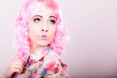 woman with pink wig creative visage - stock photo