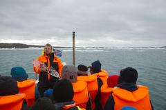 Tour on the glacial lake - stock photo