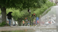 Joggers run behind fountain water slow motion 2 1009 - stock footage