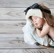 Stock Photo of Cute little boy sleeping with goggles