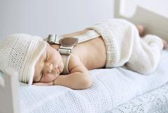 Portrait of a sleeping baby - stock photo