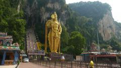 Gorgeous Murugan statue at the Batu Caves entrance, tallest golden sculpture Stock Footage