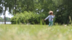 blurred: soccer playing kid running in the park - stock footage