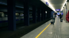 Businesswoman walking and waiting for the train on station, steadycam shot Stock Footage