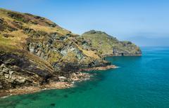 Cliffs jutting into the ocean near Tintagel Cornwall - stock photo