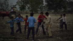 Children jumping and posing in India, long shot Stock Footage
