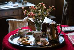 Antique china tea set on silver tray Stock Photos