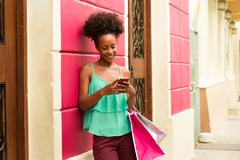 Black Girl Shopping And Text Messaging On Phone Stock Photos