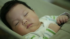Newborn baby being drowsy and fall asleep Stock Footage