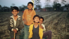 Boys posing for camera in Indian village, medium shot, shallow DOF Stock Footage