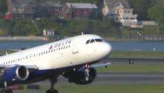 Delta Airlines jet lifts off from runway - stock footage