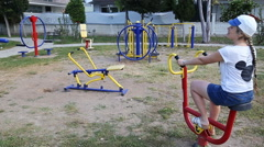 Woman exercising with exercise equipment in the public park Stock Footage