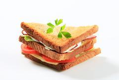 Deli sandwich with ham, cheese, egg and veggies Stock Photos