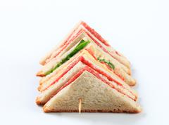 Multi-layered sandwich with thin sliced salami - stock photo
