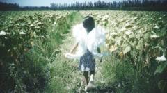 Little girl wearing angel wings Stock Footage