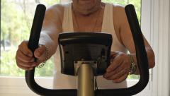 Close-Up The Old Man Riding Stationary Bike  Stock Footage