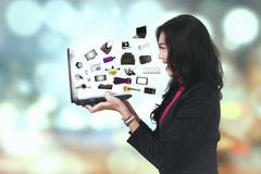Stock Photo of Cheerful woman with ecommerce products