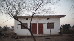 Symmetrical village house, India, long shot, shallow DOF Stock Footage