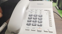Office phone using close-up Stock Footage