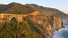 Highway 1 and Bixby Bridge sunset pan, Big Sur, California Stock Footage