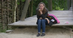 Young Woman Resting in Summer Park Stock Footage