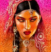 Abstract digital art of Indian or Asian woman's face, close up. - stock illustration