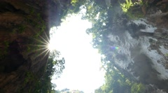 Sky window from cave floor, sunlight shine brightly, turning around Stock Footage