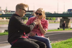 Couple smoking cigarettes and talking in the public place Stock Footage