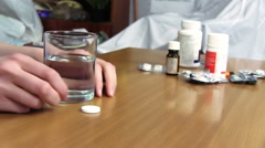 Woman Dissolving Effervescent Table Stock Footage