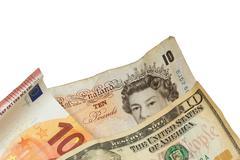 Ten pounds, ten euro and the ten dollar banknotes  isolated - stock photo