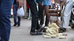 Men compressing sugar cane at street in Delhi. Stock Footage