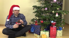 Funny gourmand man lick lips eat chocolate Christmas Santa Stock Footage