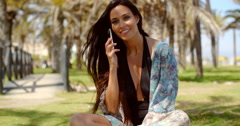 Young Lady in Beach Wear Talking on Phone Stock Footage
