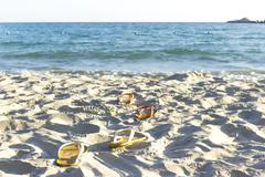 Couple sandal on the beach - stock photo