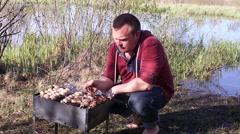Man Grilling Mushrooms and Meat Kebabs Skewers Stock Footage