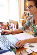 Strong independent mature woman, with her own business, working from home. Stock Photos