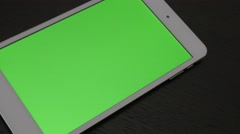 Green screen chroma  display on silver PC tablet slow panning 4K 3840X2160 UH Stock Footage
