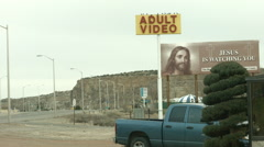 Adult Video and Jesus is Watching You Signs Stock Footage